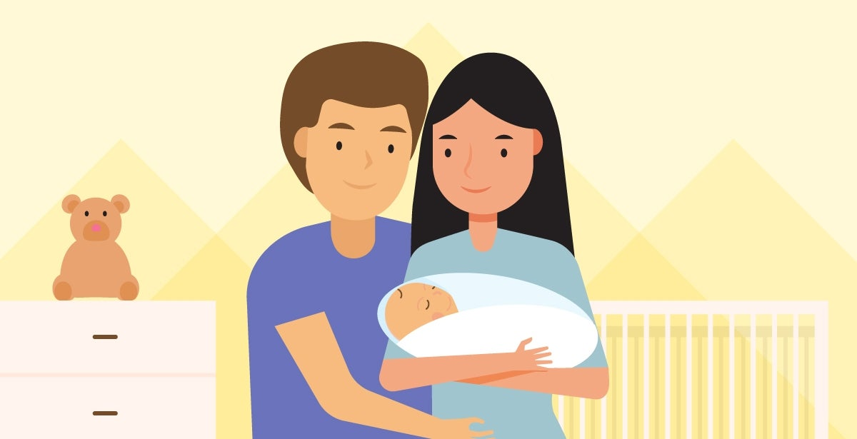 A mother and father hold a newborn baby.