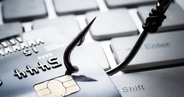 A hook phishing a credit card